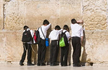 JERUSALEM , ISRAEL - AUG 06 : Young orthodox jewish in The western wall  , Important Jewish religious site located in the Old City of Jerusalem