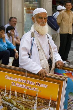 turkish man: ISTANBUL , TURKEY - AUG 6 2007 : religious turkish man in Istanbul street