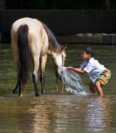 TACUAREMBO  URUGUAY, MAR. 7 2009: a child participant with his horse  in the annual  festival Patria Gaucha