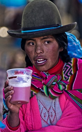 quechua: Cusco , Peru - May 27 : Peruvian woman drink