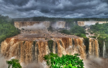 Iguasu falls , Brasil - December 07 2010 : View of the Iguasu falls , Iguasu falls are the largest series of waterfalls on the planet located in the three borders of Brasil Argentina and Paraguay