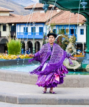 Cusco , Peru - May 25  : Peruvian dancer with traditional clothes dancing in street in Cusco Peru on May 25 2011