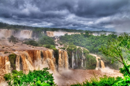 View of the Iguasu falls , Iguasu falls are the largest series of waterfalls on the planet located in the three borders of Brasil Argentina and Paraguay photo