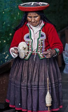 quechua: Cusco , Peru - May 26 2011 : Quechua Indian woman weaving  Editorial