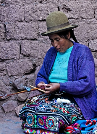 Cusco , Peru - May 26 2011 : Quechua Indian woman weaving with strap loom