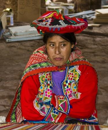 quechua: Cusco , Peru - May 26 2011 : Quechua Indian woman weaving with strap loom