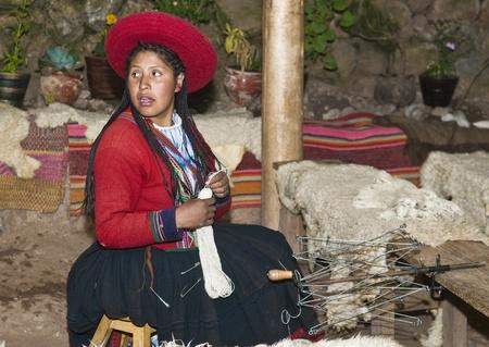 quechua indian: Cusco , Peru - May 26 2011 : Quechua Indian woman weaving with strap loom