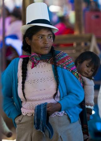 Cusco , Peru - May 28 2011 : Peruvian woman with here child in a market in Cusco Peru