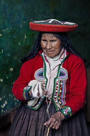 Cusco , Peru - May 26 2011 : Quechua Indian woman weaving  Stock Photo - 10591994