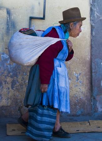 quechua: Cusco , Peru - May 31 :  Peruvian woman walk in the narrow alleys of  Cusco Peru