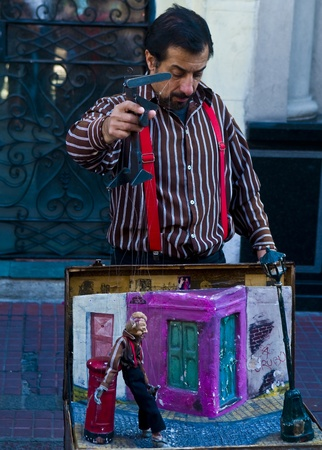 BUENOS AIRES  , ARGENTINA  - APR 24 2011 : Puppeteer in a street puppet show in Buenos aires Argentina