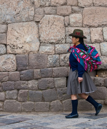 quechua: Cusco , Peru - May 25 :  Peruvian woman walk in the narrow alleys of  Cusco Peru  Editorial
