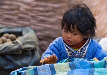 CUSCO , PERU - MAY 27  2011 : Pruvian child in a local market