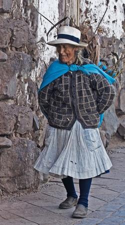 quechua: Cusco , Peru - May 26 :  Peruvian woman walk in the narrow alleys of  Cusco Peru  Editorial