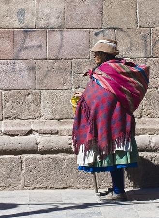 quechua: Cusco , Peru - May 28 :  Peruvian woman walk in the narrow alleys of  Cusco Peru
