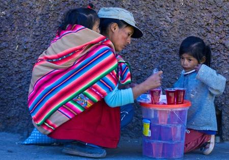 Cusco , Peru - May 28 2011 : Peruvian woman with here children in a market in Cusco Peru