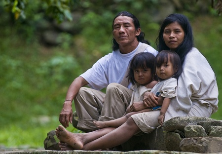 TAYRONA PARK , COLOMBIA - DECEMBER 17 2010 : Indian family sit together at home in a village in