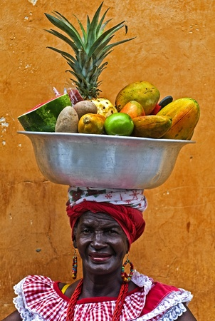 CARTAGENA DE INDIAS , COLOMBIA - DEC 21:Unidentified Palenquera woman sell fruts in Cartagena de Indias on December 21 2010,Palenqueras are  a unique African descendat ethnic group found in the north region of South America