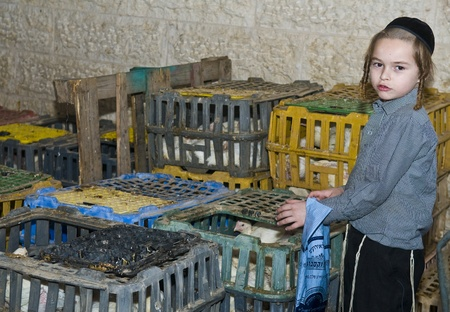 JERUSALEM - OCT 06 : An ultra Orthodox Jewish boy near a cages with chickens use for the Kapparot ceremony held in Jerusalem Israel on October 06 2011 Stock Photo - 10807666