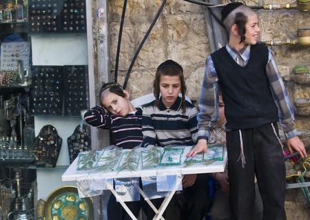 aravah: JERUSALEM - OCTOBER 10 2011: An ultra-orthodox Jewish boys sells Aravah