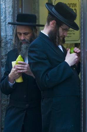 JERUSALEM - OCTOBER 10 2011 : An ultra-orthodox Jewish men inspects an Etrog Stock Photo - 10839131