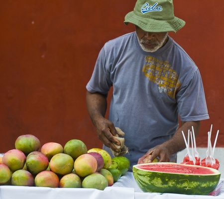 CARTAGENA DE INDIAS , COLOMBIA - DEC 21:Unidentified colombian man sell fruits in the street in Cartagena de Indias on December 21 2010