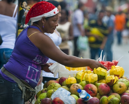 CARTAGENA DE INDIAS , COLOMBIA - DEC 21:Unidentified colombian woman sell fruits in the street of Cartagena de Indias on December 21 2010