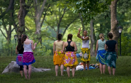 rehearse: NEW YORK - JUNE 28 2011 : A group of women rehearse belly dancing in Cental park , Manhattan
