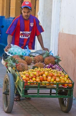 CARTAGENA DE INDIAS , COLOMBIA - DEC 20:Unidentified colombian man sell fruits in the street in Cartagena de Indias on December 20 2010