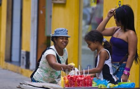 CARTAGENA DE INDIAS , COLOMBIA - DEC 21:Unidentified colombian woman sell fruits in the street in Cartagena de Indias on December 21 2010