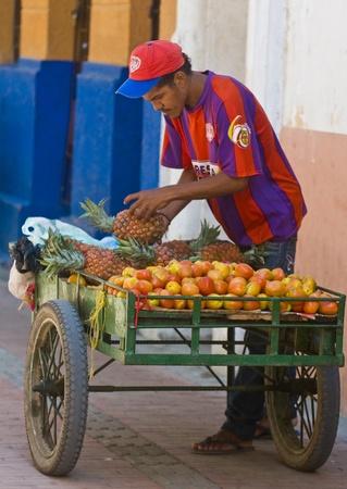 CARTAGENA DE INDIAS , COLOMBIA - DEC 20:Unidentified colombian man sell fruits in the street in Cartagena de Indias on December 20 2010 Stock Photo - 11026009