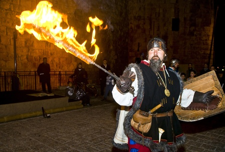 JERUSALEM - NOV 03 : An Italian actor dresses as knight fight with sword and fire in the annual medieval style knight festival held in the old city of Jerusalem on November 03 2011