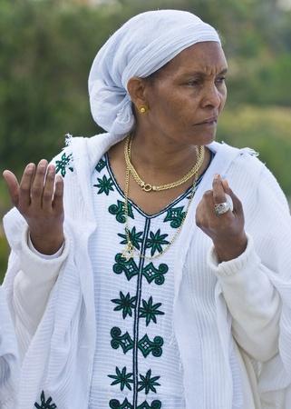 JERUSALEM - NOV 24 : Ethiopian woman prays during  the