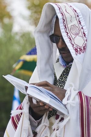 JERUSALEM - NOV 24 : Ethiopian jew prays during the Sigd holiday in Jerusalem . Israel on November 24 2011 , The Jewish Ethiopean community celebrates the Sigd annually in Jerusalem Editorial