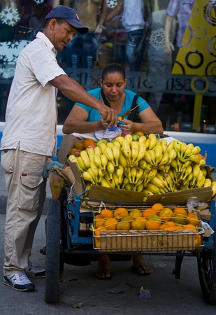 CARTAGENA DE INDIAS , COLOMBIA - DEC 18 :Unidentified colombian woman sell fruits in the street in Cartagena de Indias on December 18 2010