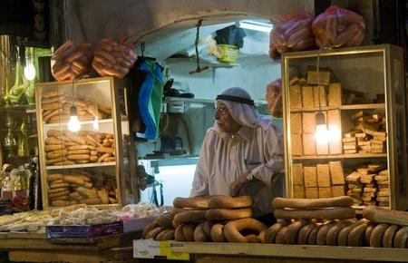 palestinian: JERUSALEM - OCTOBER 06 2011 : Palestinian bread seller in the old city of Jerusalem , Israel Editorial