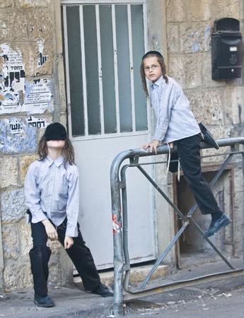 hasid: JERUSALEM - OCTOBER 06 2011 : Jewish ultra orthodox children in the Mea Shearim district  Jerusalem , Israel