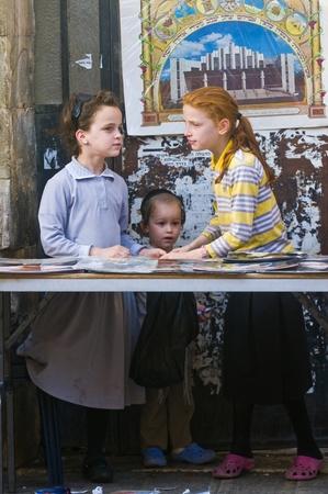 hasid: JERUSALEM - OCTOBER 10 2011 : Jewish ultra orthodox children in the Mea shearim district in Jerusalem Israel