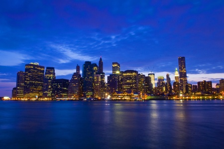 New York city skyline by night taken from Brooklyn photo