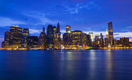 New York city skyline by night taken from Brooklyn Stock Photo