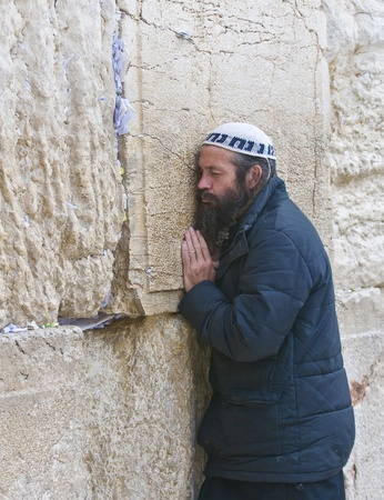 selichot: JERUSALEM - SEP 26 : Jewish man prays during the penitential prayers the Selichot , held on September 26 2011 in the Wailing wall  in  Jerusalem , Israel  Editorial