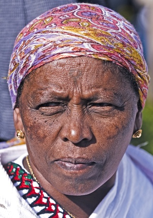 exprassion: JERUSALEM - NOV 24 : Portrait of Ethiopian Jew woman during the Sigd holiday in Jerusalem . Israel on November 24 2011 , The Jewish Ethiopean community celebrates the Sigd annualy in Jerusalem Editorial