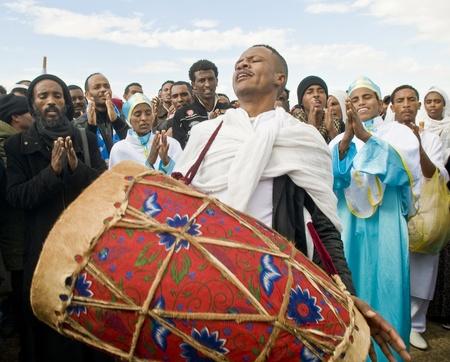 ethiopian: QASER EL YAHUD , ISRAEL - JAN 19 : Unidentified Ethiopian orthodox Christians  participates in the baptising ritual during the epiphany at Qaser el yahud , Israel in January 19 2012