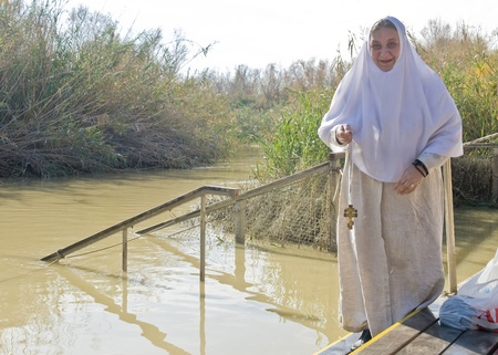 QASER EL YAHUD , ISRAEL - JAN 18 : Unidentified pilgrim woman participates in the baptising ritual during the epiphany at Qaser el yahud , Israel in January 18 2012