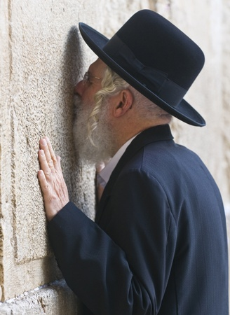 JERUSALEM - NOVEMBER 03 2011 - Orthodox jewish man prays in The western wall  , An Important Jewish religious site located in the Old City of Jerusalem , Israel Stock Photo - 12445093