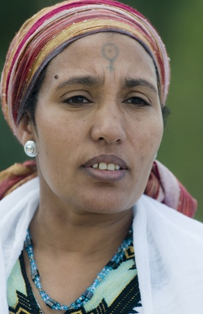 JERUSALEM - NOV 24 : Portrait of Ethiopian Jew woman during the Sigd holiday in Jerusalem . Israel on November 24 2011 , The Jewish Ethiopean community celebrates the Sigd annualy in Jerusalem Editorial