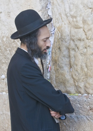 JERUSALEM - FEB 05 : Orthodox jewish man prays in The western wall on February 05 2011 , The Western wall is important Jewish religious site located in the Old City of Jerusalem , Israel