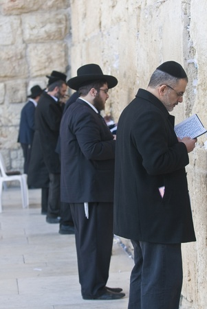 JERUSALEM - FEB 05 : Orthodox jewish men prays in The western wall on February 05 2011 , The Western wall is important Jewish religious site located in the Old City of Jerusalem , Israel