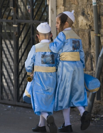 JERUSALEM - MARS 09 : Ultra Orthodox children during Purim in Mea Shearim Jerusalem on Mars 09 2012 , Purim is a Jewish holiday celebrates the salvation of the jews from jenocide in ancient Persia  Stock Photo - 12618646