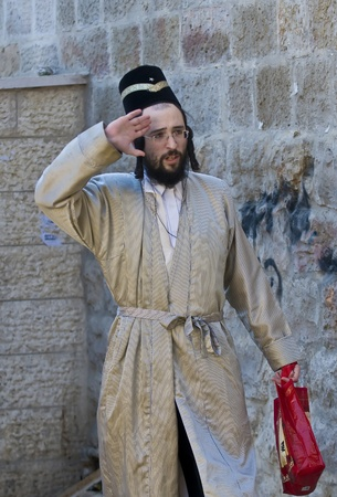 JERUSALEM - MARS 09 : Ultra Orthodox man during Purim in Mea Shearim Jerusalem on Mars 09 2012 , Purim is a Jewish holiday celebrates the salvation of the jews from jenocide in ancient Persia  Stock Photo - 12618678